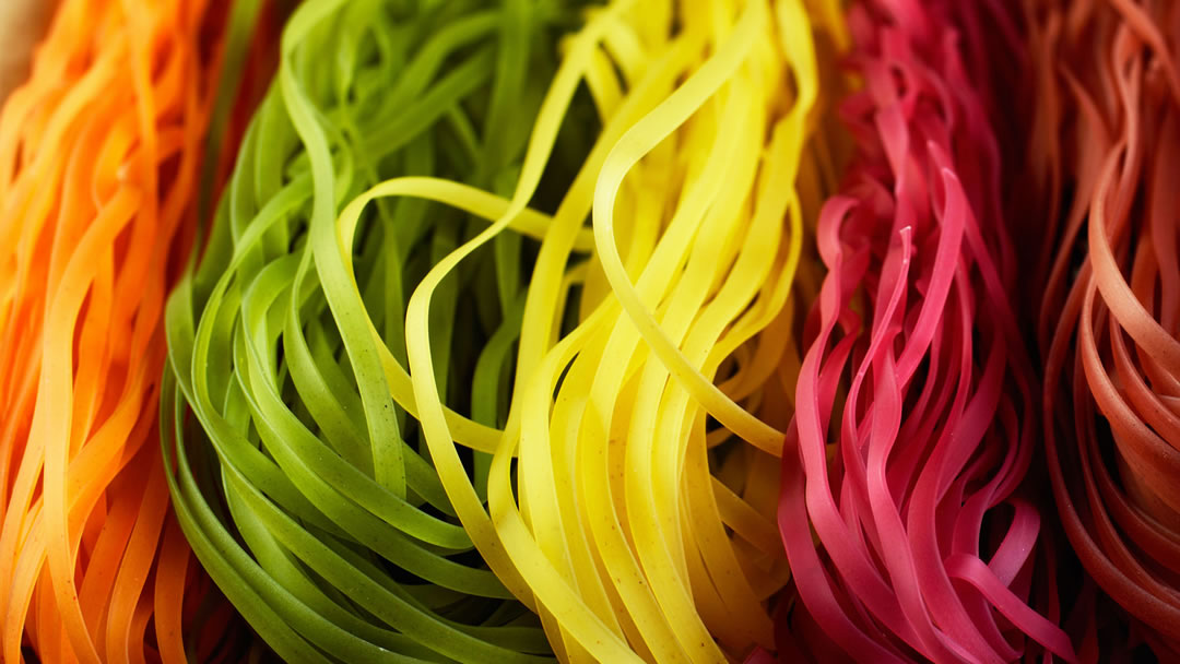 Coloured and flavoured pasta
